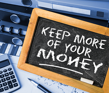chalkboard that says keep more of your money