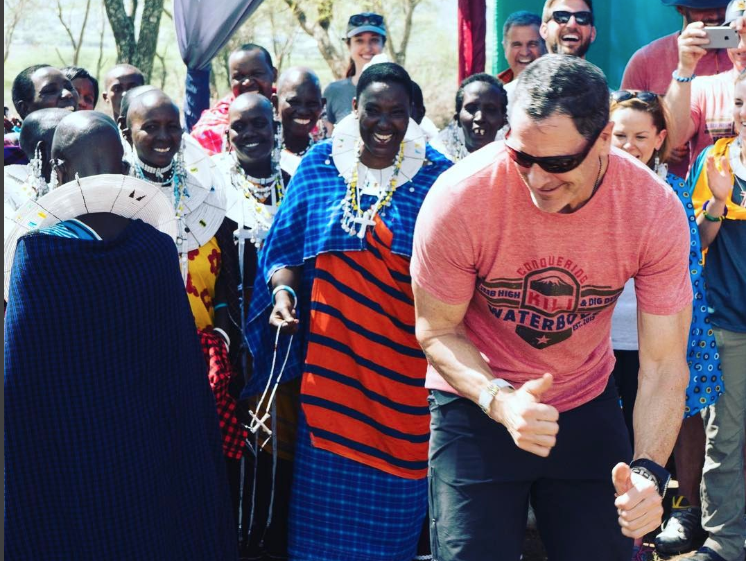 Mark Pattison dancing in Tanzania