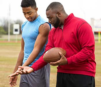 Coach teaching athlete