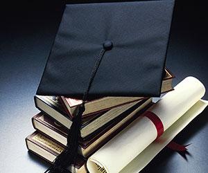 graduation scroll and cap