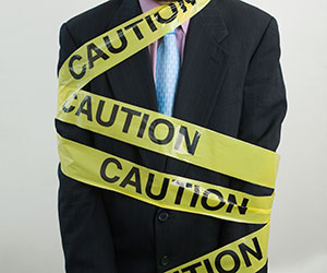 self expression suit covered in caution