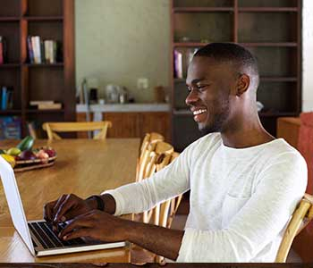 Man on computer at home