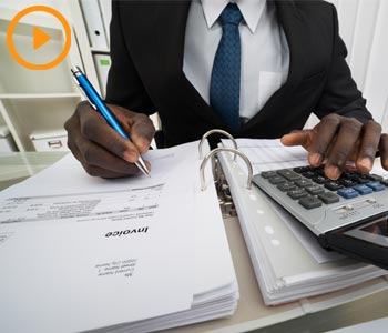 Man at desk with financial papers